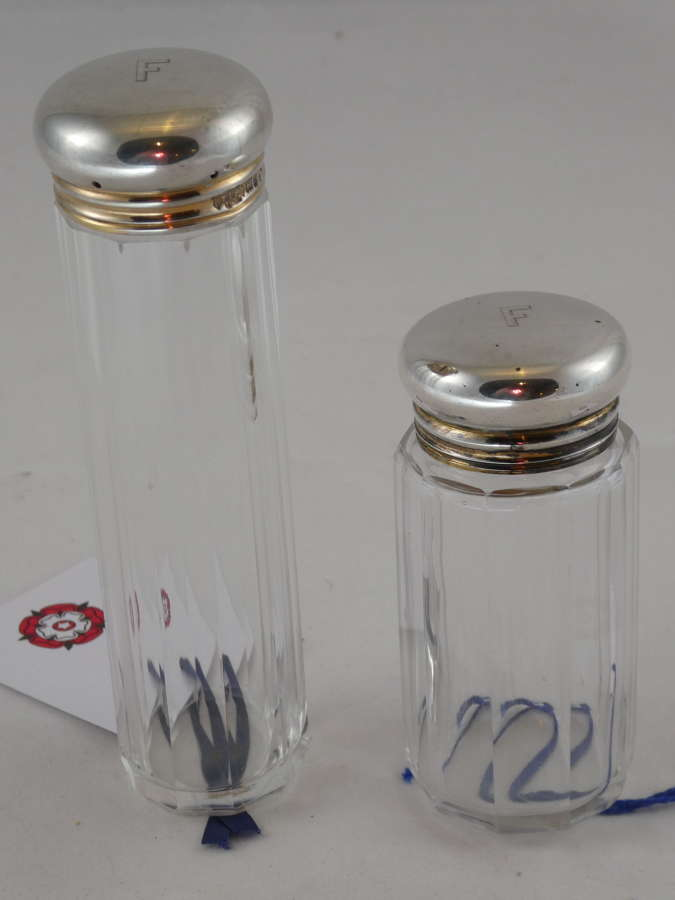 Two Silver Topped Bottles