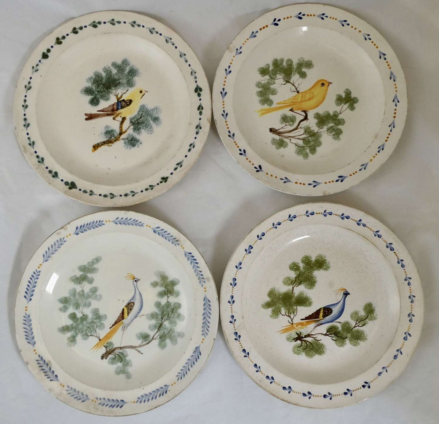Set of Four Creamware Plates