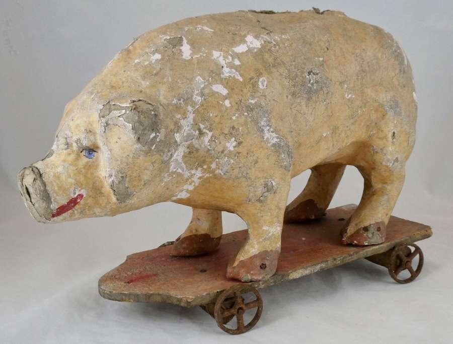 Papier-maché Pig on Wheels, circa 1900